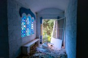 abandoned orthodox church with stained glass and door